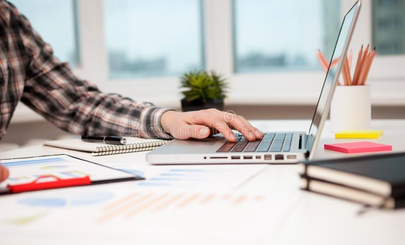 businessman working laptop at the desk in modern office royalty free stock images