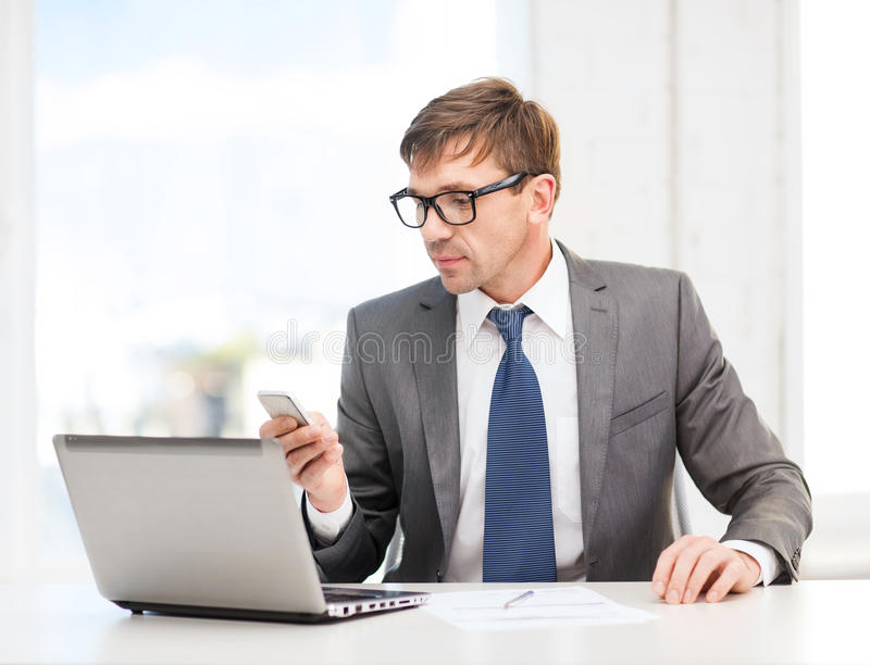 Download Businessman Working With Laptop And Smartphone Stock Image - Image of middle, notes: 34954269