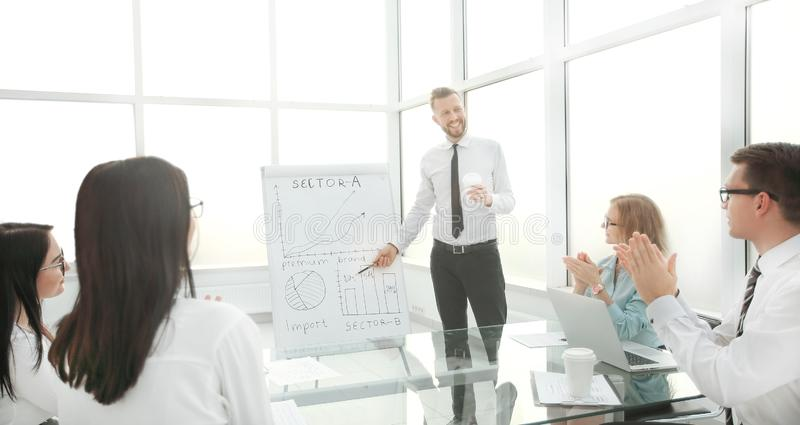 Businessman at a working meeting with the business team. royalty free stock image