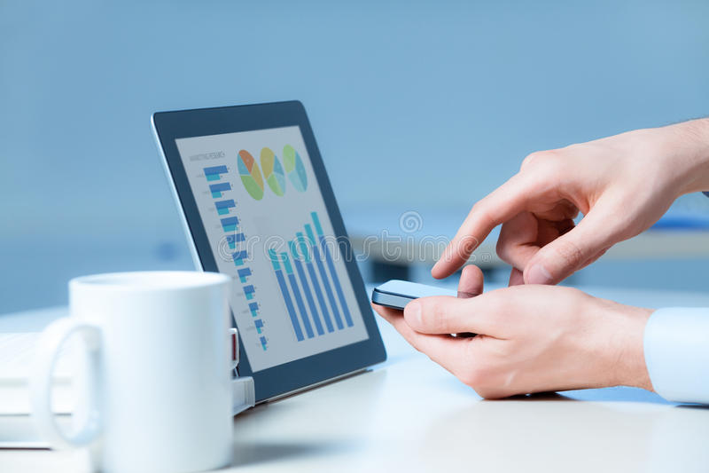 Businessman Working With Modern Devices stock photo