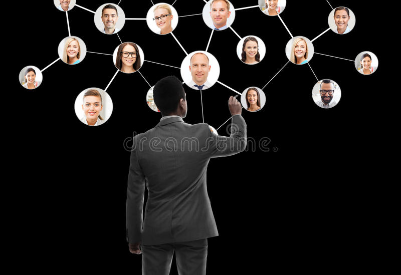 Businessman working with network contacts icons. Business, people, human resources, headhunting and technology concept - businessman with marker and network royalty free stock photos