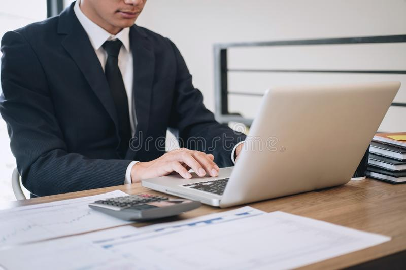 Businessman working new project on laptop computer with report document and analyze, calculating financial data on graph documents. Doing finance making notes stock photos
