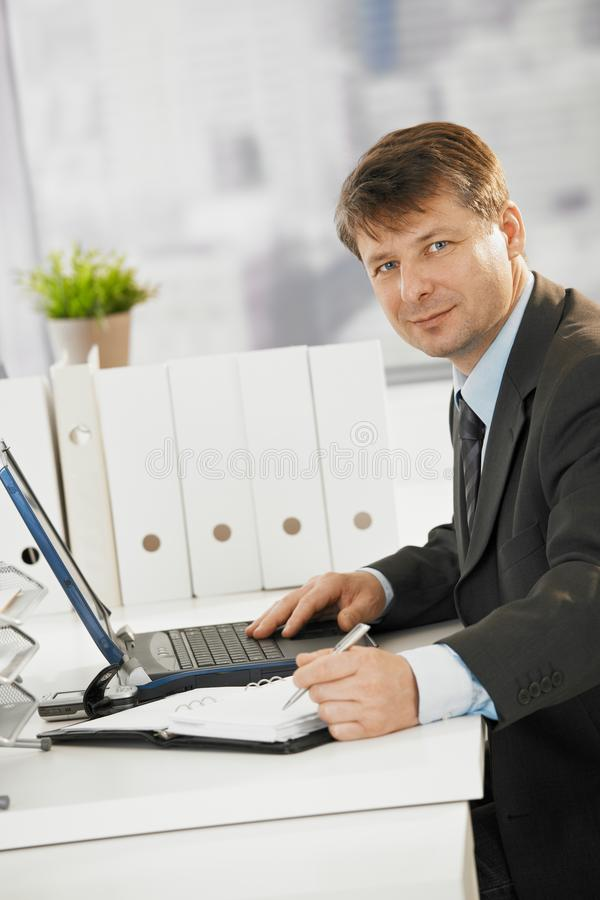 Businessman working in office royalty free stock images