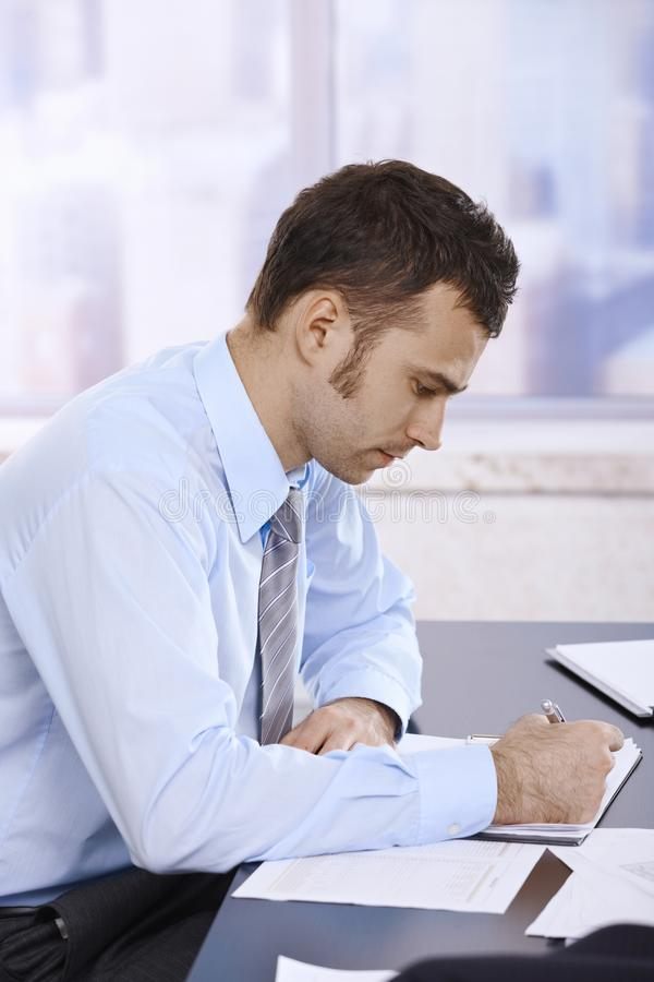 Download Businessman Working In Office Stock Photo - Image: 25641952