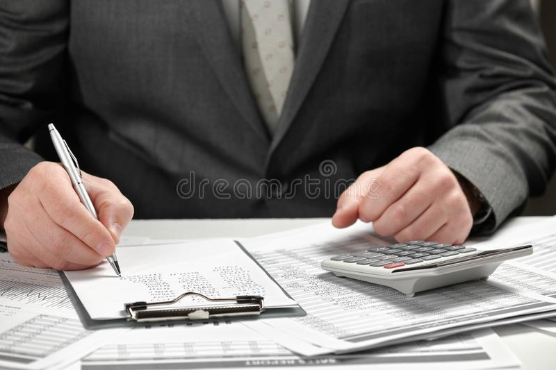 Businessman working in an office. Hands and documents closeup stock photo