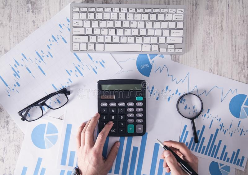 Businessman working in office and using calculator stock image