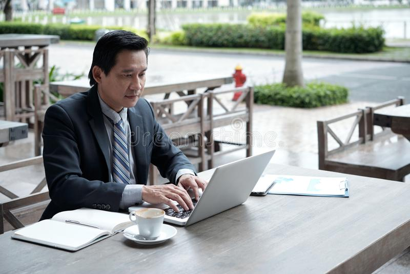 Businessman working in outdoor cafe royalty free stock photos