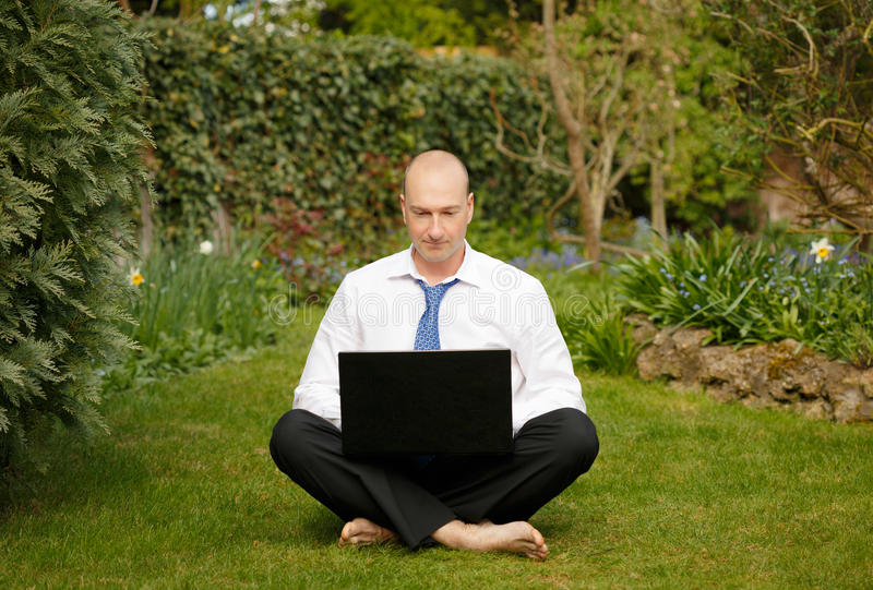 Businessman working outdoors royalty free stock photography
