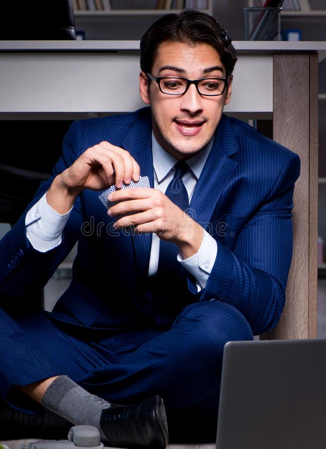 Businessman working overtime long hours late in office. The businessman working overtime long hours late in office royalty free stock image