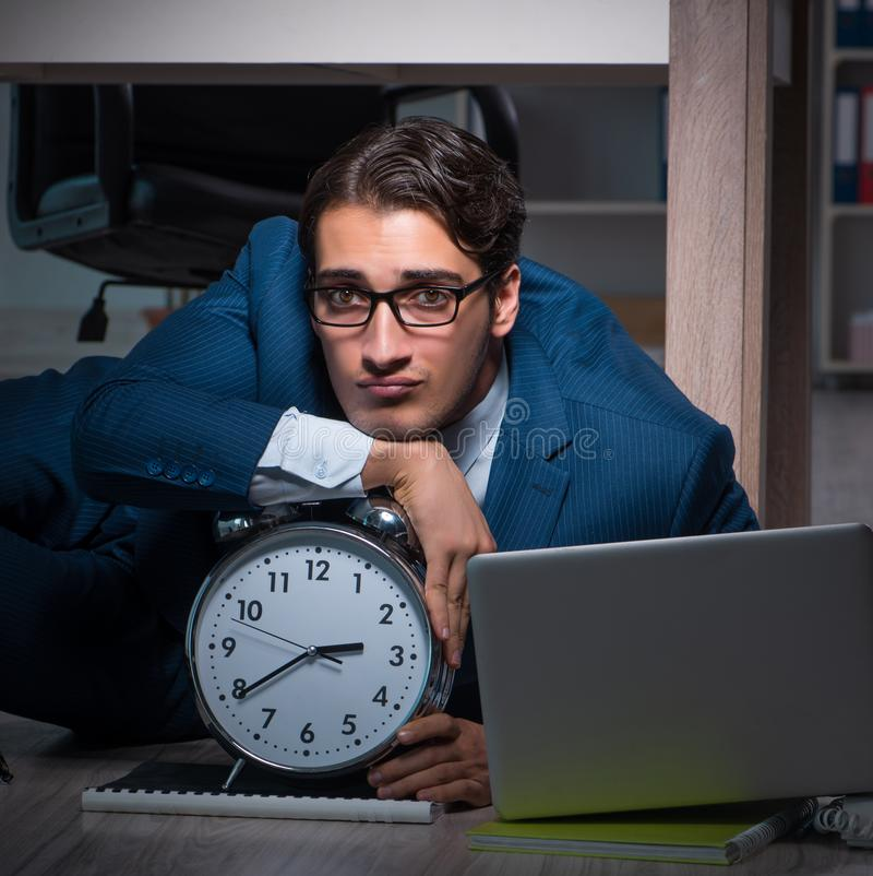 Businessman working overtime long hours late in office. The businessman working overtime long hours late in office royalty free stock images