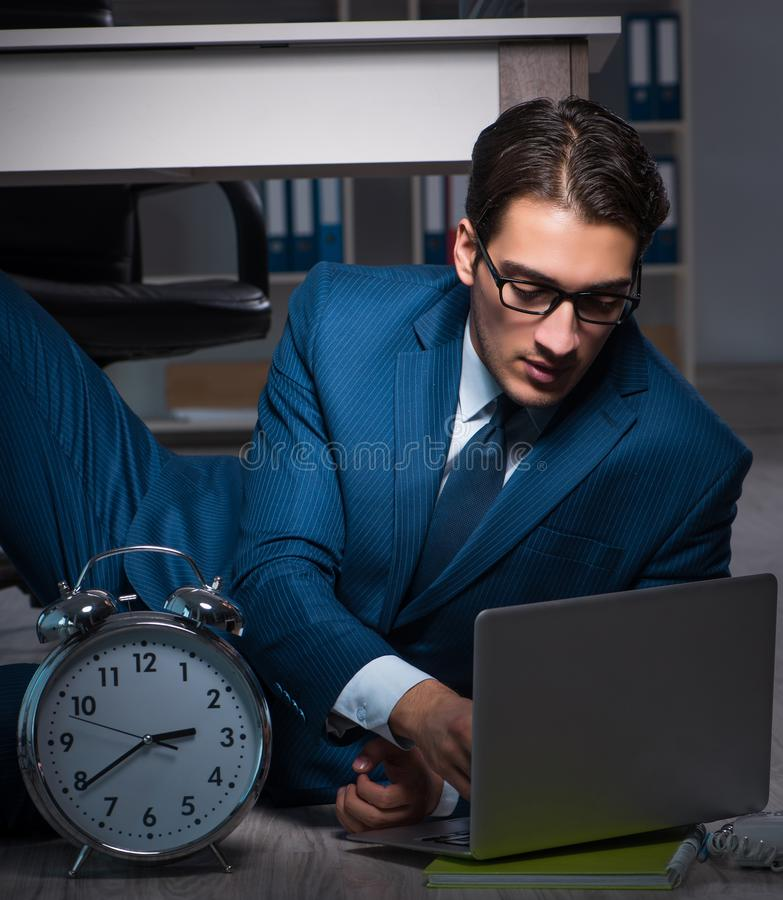 Businessman working overtime long hours late in office. The businessman working overtime long hours late in office royalty free stock photography