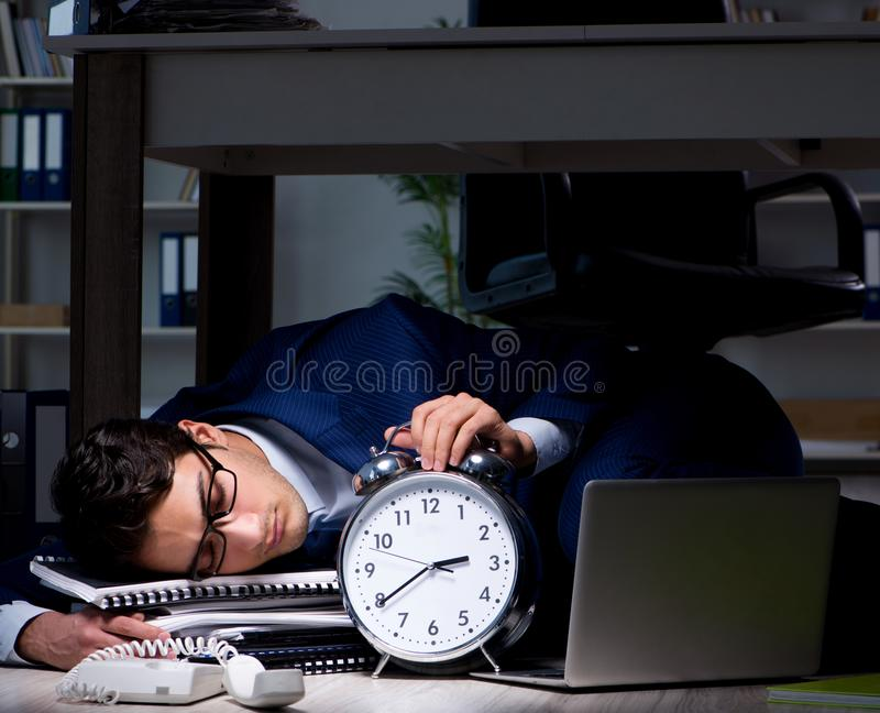 Businessman working overtime long hours late in office. The businessman working overtime long hours late in office stock photos
