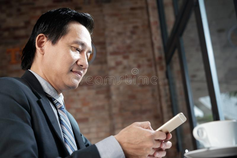 Businessman working on phone royalty free stock images
