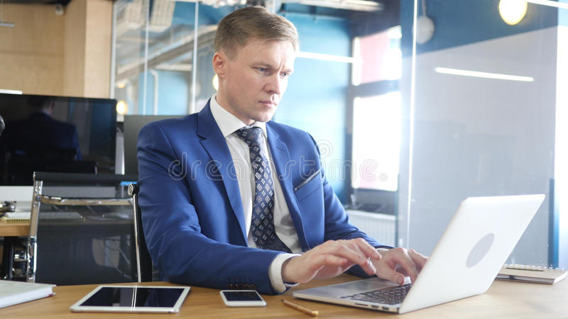 Businessman Working on Project in Office stock photography