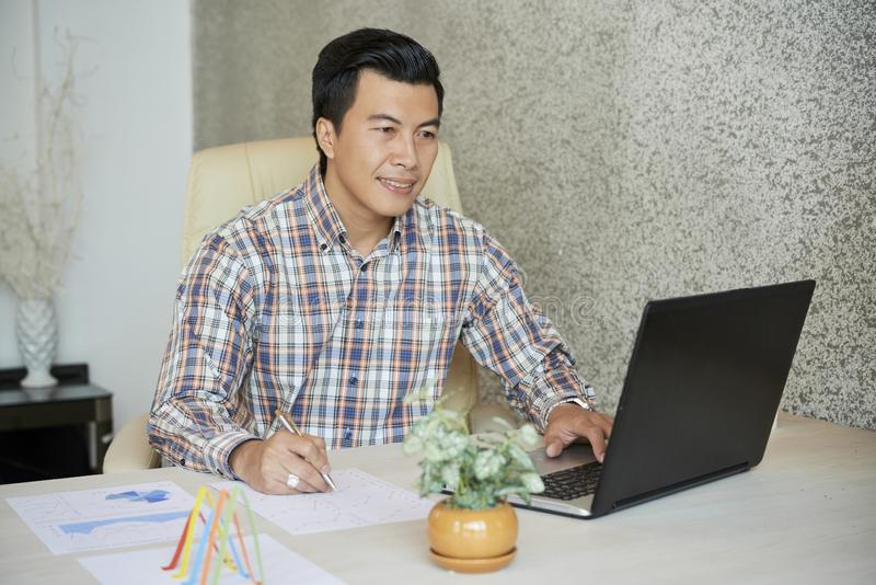 Businessman working with reports stock photo