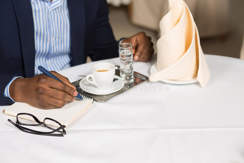 Businessman working in restaurant stock photo