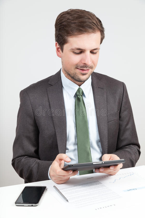 Businessman working with tablet stock images