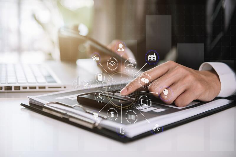 Businessman working with tablet and using a calculator to calculate the numbers of static in office. Finance accounting concept royalty free stock photos