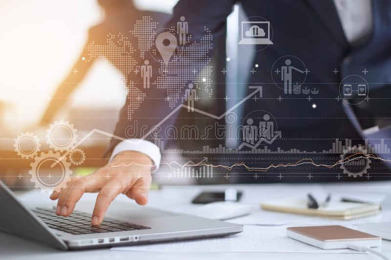 Businessman using laptop showing growth on virtual screen. Businessman working using laptop computer with strategy and growth of business on screen stock images