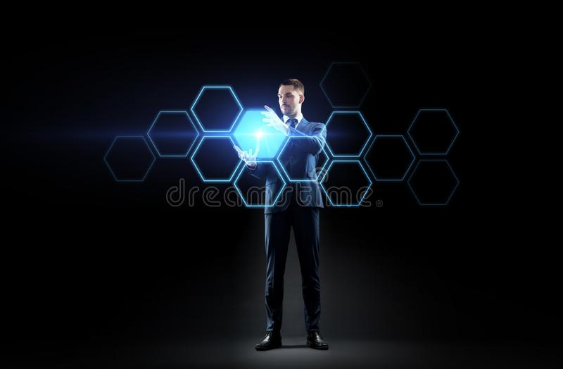Businessman working with virtual network hologram. Business, people, augmented reality and future technology concept - businessman working with virtual network royalty free stock image
