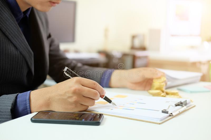 Businessman working on workplace with analysis chart data, Audit royalty free stock image