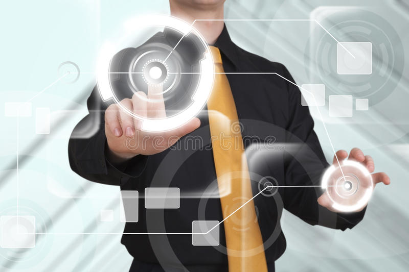 Businessman works on huge touch screen. stock photo