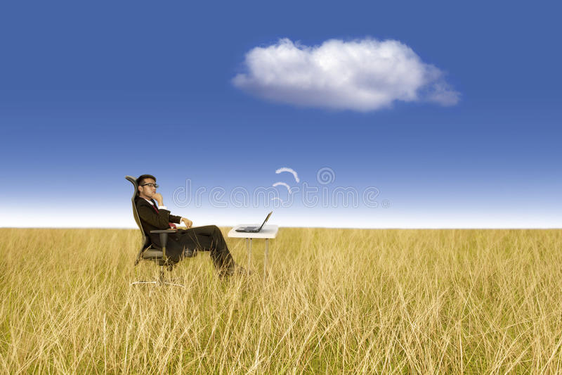 Businessman works outdoor. Cloud computing concept: Works anywhere stock photos
