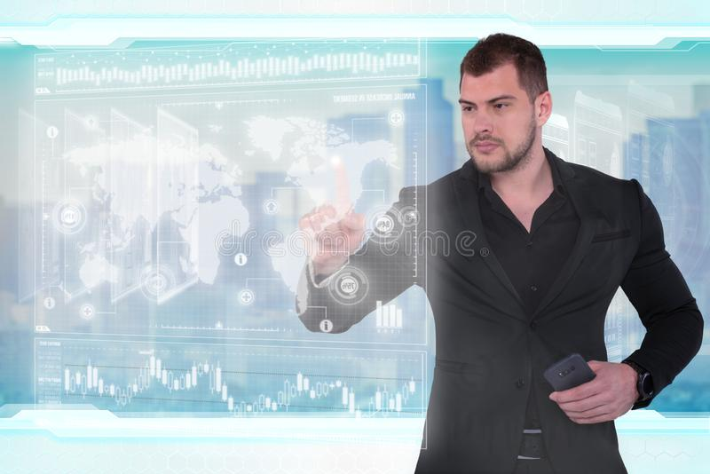 Businessman works with virtual holographic interface. Future technology concept stock photography