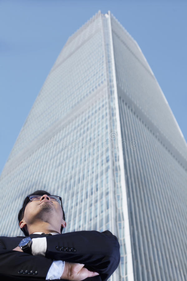 Businessman by the world trade center in Beijing, China stock image