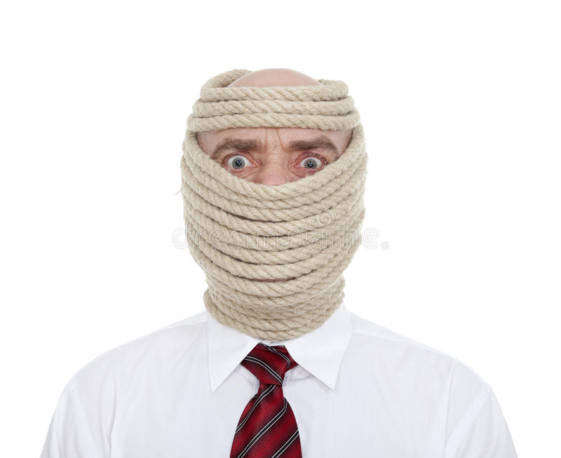 Businessman wrapped face stock photo