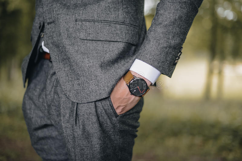 Businessman with wrist watch royalty free stock photos