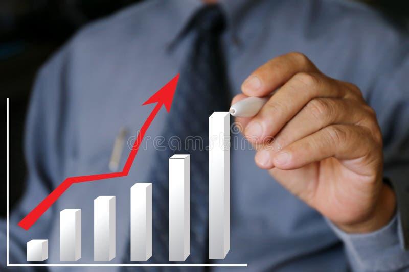 Businessman write graph chart, financial stock photo