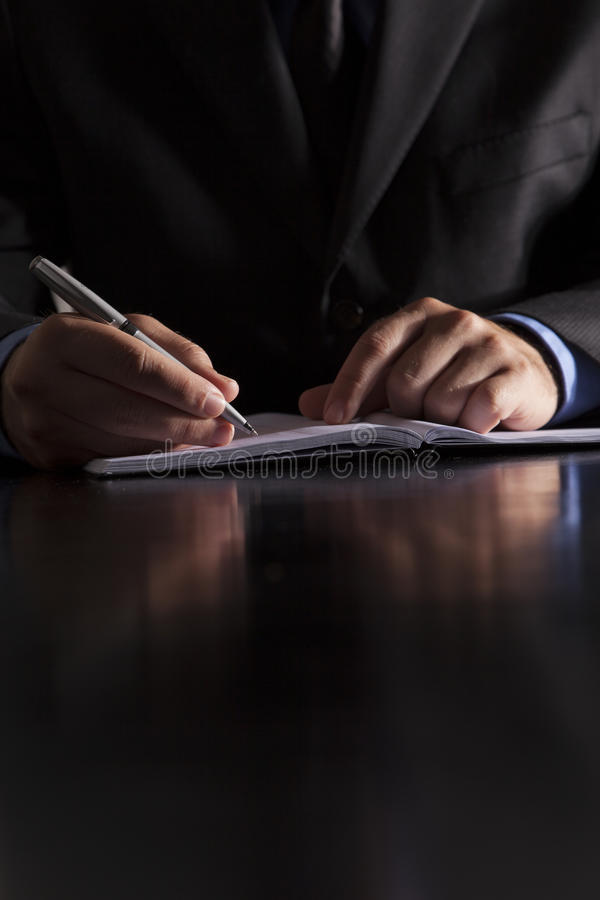 Download Businessman Writes In Notebook Stock Photo - Image: 26288392