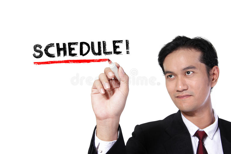 Businessman writes Schedule. Business man underlining the word `Schedule` on screen, over white background royalty free stock image