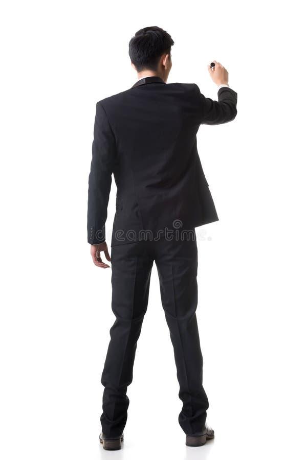 Businessman writing royalty free stock photo