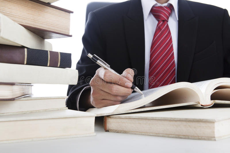 Businessman writing on a book stock images