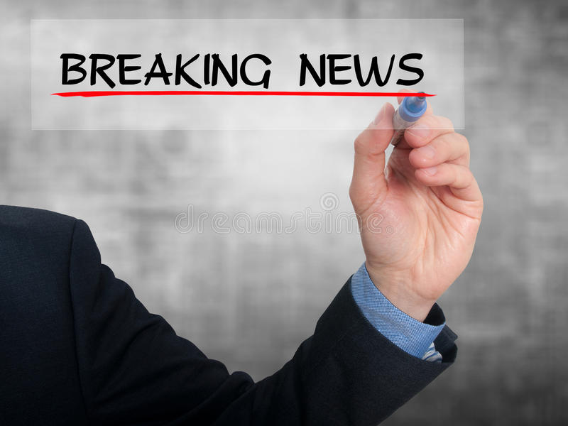 Businessman writing breaking news in the air - Stock Image stock images