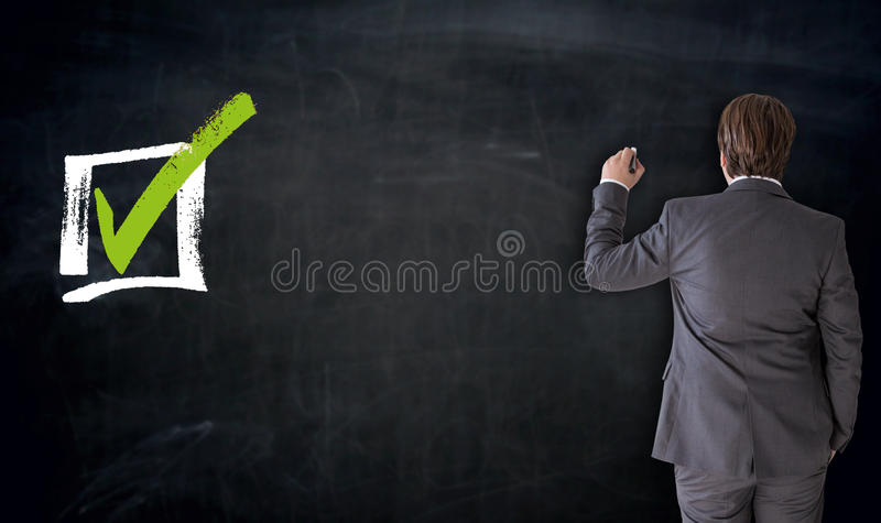 Businessman writing with checkbox concept on blackboard.  royalty free illustration