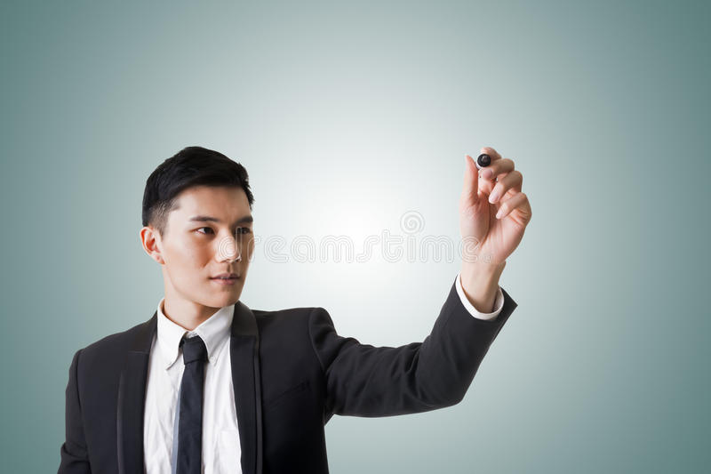 Businessman writing or drawing stock photography