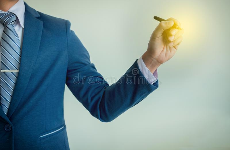 Businessman writing, drawing on the blank screen with copy space royalty free stock photos