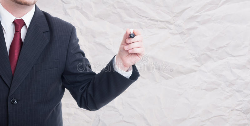 Businessman writing or drawing on blank singboard royalty free stock images
