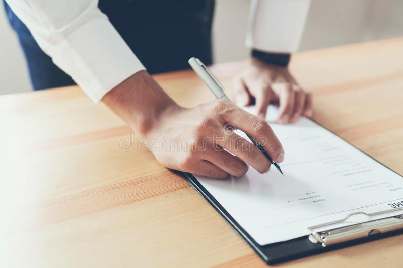 Businessman writing form submit resume employer to review job application. Concept presents ability for the company to agree with position of job stock photography