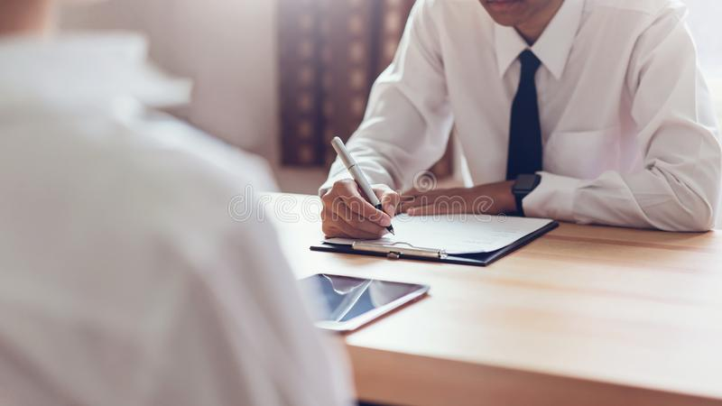 Businessman writing form submit resume employer to review job application. Concept presents ability for the company to agree with position of job royalty free stock image