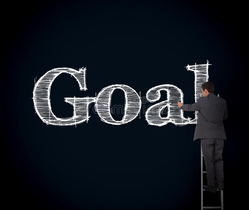 Download Businessman Writing Goal On A Giant Blackboard Stock Photo - Image: 30887264