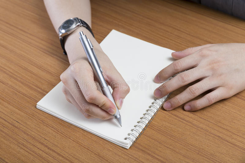 businessman writing note on notepad royalty free stock images