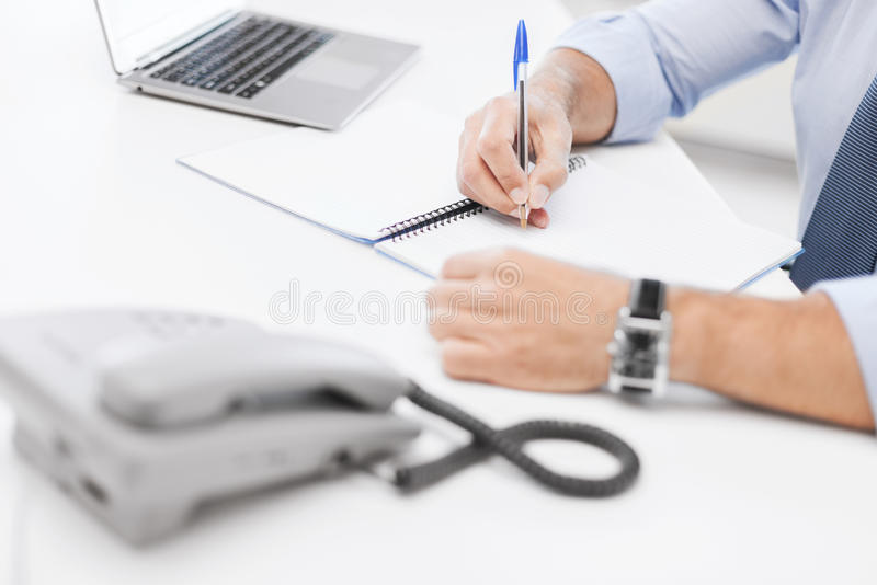Businessman writing in notebook. Business, office, school and education concept - businessman writing in notebook stock photos