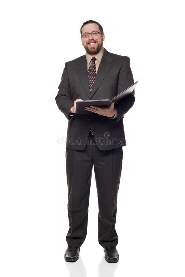 Businessman writing on notepad stock photos