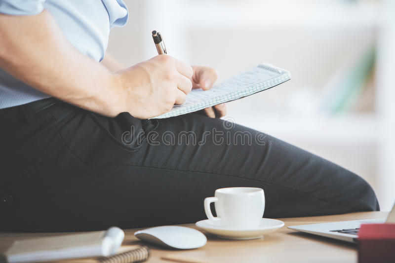 Businessman writing in notepad closeup royalty free stock photography
