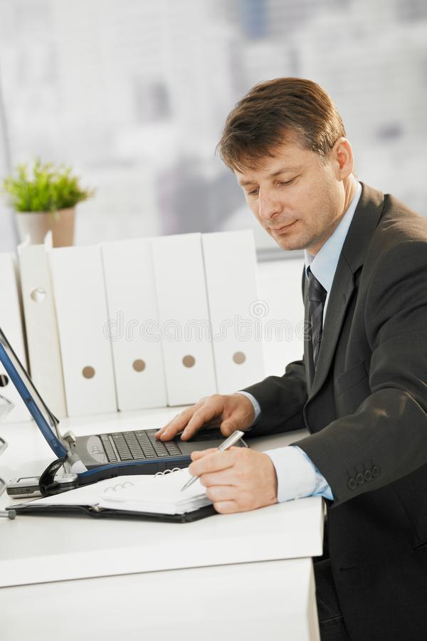 Download Businessman Writing Notes To Organizer Stock Photo - Image: 18506278