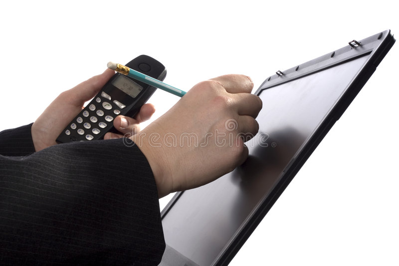 Businessman writing notes on a touchscreen
